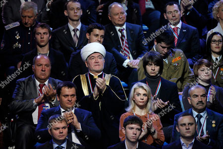 Ravil Gainutdin Russia's chief Mufti Ravil Gainutdin, center, attends the United Russia party congress in Moscow in Moscow, Russia, . Prime Minister Vladimir Putin on Sunday sternly warned the West against interfering in Russia's elections in a speech before thousands of cheering supporters as he formally launched his presidential bid