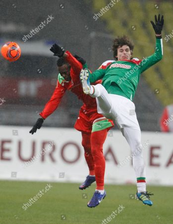 Victor Obinna, Ander Iturraspe Lokomotiv Moscow's Victor Obinna, and Athletic Bilbao's Ander Iturraspe compete for the ball during their Europa League round of 32 first leg soccer match at the Luzhniki stadium in Moscow, Russia