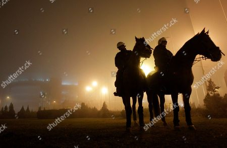 Serbian police officers on horses patrol around the Belgrade Arena, before Bosnian pop singer Dino Merlin's concert, in Belgrade, Serbia, Friday, Nov.25, 2011. This is the first concert in Belgrade after more than 20 years, after breakup of Yugoslavia. Serbian ultra-nationalists called Serbian fans to boycott the event