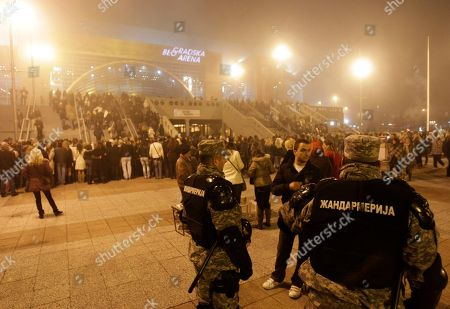 Serbian police officers guard Belgrade Arena, before Bosnian pop singer Dino Merlin's concert, in Belgrade, Serbia, Friday, Nov.25, 2011. This is the first concert in Belgrade after more than 20 years, after breakup of Yugoslavia. Serbian ultra-nationalists called Serbian fans to boycott the event