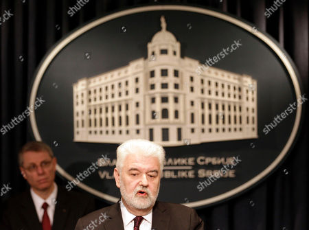 Mirko Cvetkovic, David J. Rintoul Serbian Prime Minister Mirko Cvetkovic, front, addresses the media after signing the agreement with U.S. Steel Vice President of European Operations David J. Rintoul, left, in Belgrade, Serbia, . Serbia's government on Tuesday bought back from U.S. Steel its loss-making plant in the Balkan country for a symbolic $1, with a goal to avoid its closure and the layoff of 5,400 of its workers