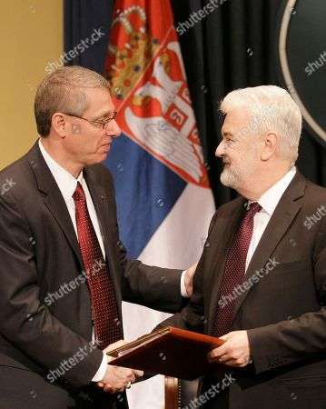 Mirko Cvetkovic, David J. Rintoul U.S. Steel Vice President of European Operations David J. Rintoul, left, shakes hands with Serbian Prime Minister Mirko Cvetkovic after signing an agreement, in Belgrade, Serbia, . Serbia's government on Tuesday bought back from U.S. Steel its loss-making plant in the Balkan country for a symbolic $1, with a goal to avoid its closure and the layoff of 5,400 of its workers