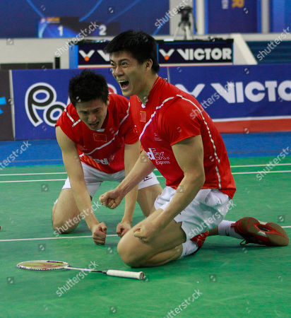 China's Cai Yun, back, and Fu Haifeng react after they defeated South Korea's Jung Jae-sung and Lee Yong-dae in men's doubles final match at the Korea Open Badminton Super Series Premier in Seoul, South Korea, . China defeated South Korea 2-1