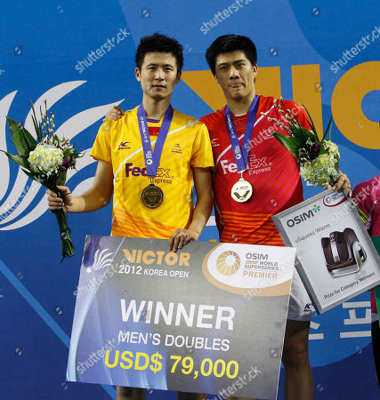 Winner China's Cai Yun, left, and Fu Haifeng pose for photo after men's doubles final match against South Korea's Jung Jae-sung and Lee Yong-dae at the Korea Open Badminton Super Series Premier in Seoul, South Korea, . China defeated South Korea 2-1