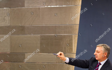 Government spokesman and Spanish Development Minister Jose Blanco, of the Spanish Socialist Workers' Party or PSOE, points his pen during a press conference after a Ministerial meeting at the Monlcoa Palace, in Madrid, . Blanco announced the decisions taken in the first cabinet meeting almost a week after the opposition Popular Party won the general elections