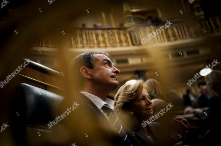 Jose Luis Rodriguez Zapatero Spain's Prime Minister Jose Luis Rodriguez Zapatero, left, and Spain's Economy Minister Elena Salgado, right, wait for the conservative leader and Spain's next prime minister Mariano Rajoy speech at the Parliament, in Madrid, . Rajoy, who will be voted in as premier on Tuesday, said his incoming conservative government aims to reduce Spain's deficit by euro 16.5 billion ($21.6 billion) next year