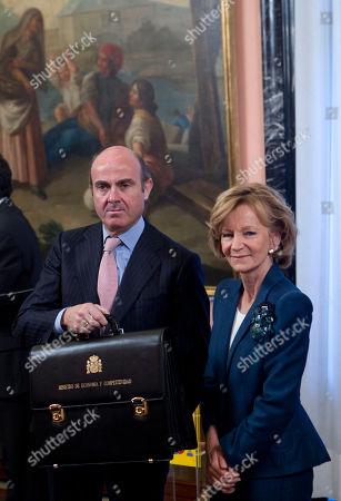 Stock Picture of Luis de Guindos, Elena Salgado Spain's new Finance Minister Luis de Guindos, left holds up his minister's briefcase next to Spain's former Finance Minister Elena Salgado in the Finance Ministry in Madrid . New conservative Spanish Prime Minister Mariano Rajoy who won a landslide victory in Nov. 20 elections on promises to lift Spain out of economic turmoil, has appointed 12 ministers