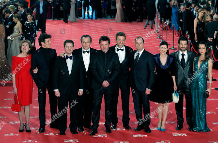 """Enrique Urbizu Spanish film director Director Enrique Urbizu, fifth left, and the technical team and actors from the film """"No habra paz para los malvados"""" poses on arrival for the """"Goya"""" Film awards ceremony in Madrid, Spain"""
