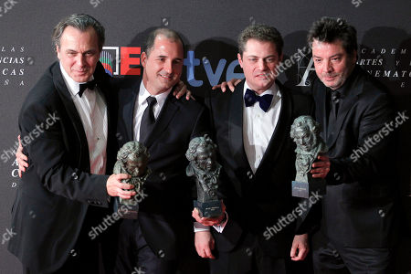 """Jose Coronado, Enrique Urbizu From left to right: Spanish actor Jose Coronado, winner of the best male actor award, best director winner Enrique Urbizu, and technical team winners hold their Goya trophies for the film """"No habra paz para los malvados"""", which won for best film, at the Goya film awards in Madrid, Spain"""