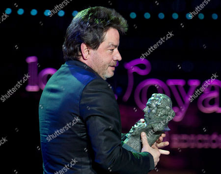 """Enrique Urbizu Director Enrique Urbizu collects his Goya award after winning in the best film and best director categories for """"No habra paz para los malvados"""" during the annual Goya film awards in Madrid on the early hours of"""