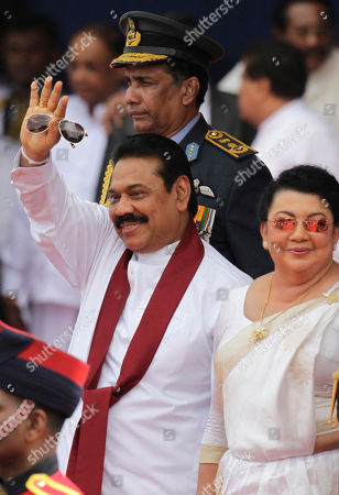 Mahinda Rajapaksa, Shiranthi Rajapaksa Sri Lankan President Mahinda Rajapaksa, left, waves as he walks with his wife Shiranthi Rajapaksa during a parade celebrating Sri Lanka's 64th Independence Day, marking the country's independence from British colonial rule in 1948, in Anuradhapura, about 80 kilometers (50 miles) north of Colombo, Sri Lanka