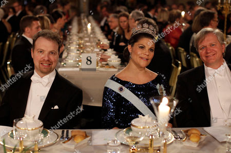 Stock Picture of The 2011 Nobel Prize Laureates for Physics Professor Adam G. Riess, left, from the U.S. and Dr Brian P. Schmidt, right, from Australia smile for photographers as they flank Victoria, Crown Princess of Sweden at the start of the 2011 Nobel Prize Banquet at the Town Hall in Stockholm