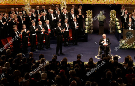 The 2011 Nobel Prize Laureate for Literature author Tomas Transtromer, in wheelchair, from Sweden is applauded after receiving his Nobel Prize from Sweden's King Carl XVI Gustaf, not pictured, during the Nobel Prize award ceremony at the Stockholm Concert Hall in Stockholm