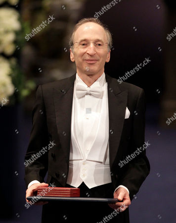 The 2011 Nobel Prize Laureate for Physics Professor Saul Perlmutter from the U.S. stands to the applause of the audience after receiving his Nobel Prize from Sweden's King Carl XVI Gustaf, not pictured, during the Nobel Prize award ceremony at the Stockholm Concert Hall in Stockholm