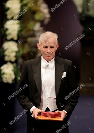 Stock Image of The 2011 Nobel Prize Laureate for Economic Sciences Professor Christopher A. Sims from the U.S. stands to the applause after receiving his Nobel Prize from Sweden's King Carl XVI Gustaf, not pictured, during the Nobel Prize award ceremony at the Stockholm Concert Hall in Stockholm
