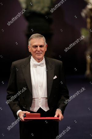 Stock Photo of The 2011 Nobel Prize Laureate for Chemistry Professor Dan Shechtman from Israel listens to the applause after receiving his Nobel Prize from Sweden's King Carl XVI Gustaf during the Nobel Prize award ceremony at the Stockholm Concert Hall in Stockholm