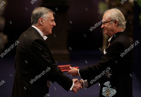 The 2011 Nobel Prize Laureate for Chemistry Professor Dan Shechtman from Israel receives his Nobel Prize from Sweden's King Carl XVI Gustaf, right, during the Nobel Prize award ceremony at the Stockholm Concert Hall in Stockholm