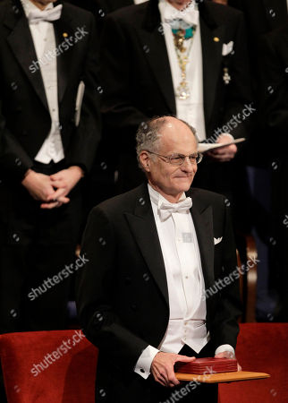 The 2011 Nobel Prize Laureates for Economic Sciences Professor Thomas J. Sargent stands for the applause from the audience after receiving his Nobel Prizes from Sweden's King Carl XVI Gustaf, not pictured, during the Nobel Prize award ceremony at the Stockholm Concert Hall in Stockholm