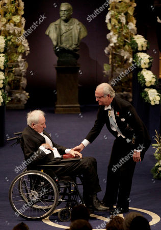 The 2011 Nobel Prize Laureate for Literature author Tomas Transtromer from Sweden receives his Nobel Prize from Sweden's King Carl XVI Gustaf, right, during the Nobel Prize award ceremony at the Stockholm Concert Hall in Stockholm