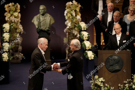 Stock Photo of The 2011 Nobel Prize Laureate for Economic Sciences Professor Christopher A. Sims, left, from the U.S. receives his Nobel Prize from Sweden's King Carl XVI Gustaf during the Nobel Prize award ceremony at the Stockholm Concert Hall in Stockholm
