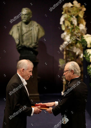 The 2011 Nobel Prize Laureate for Economic Sciences Professor Christopher A. Sims, left, from the U.S. receives his Nobel Prize from Sweden's King Carl XVI Gustaf during the Nobel Prize award ceremony at the Stockholm Concert Hall in Stockholm