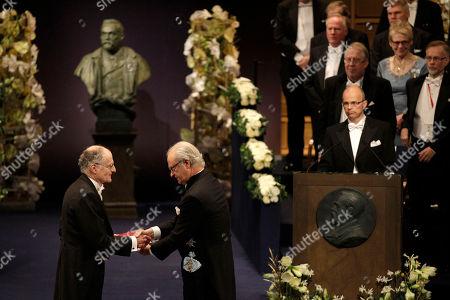 The 2011 Nobel Prize Laureate for Economic Sciences Professor Thomas J. Sargent, left, from the U.S. receives his Nobel Prize from Sweden's King Carl XVI Gustaf during the Nobel Prize award ceremony at the Stockholm Concert Hall in Stockholm