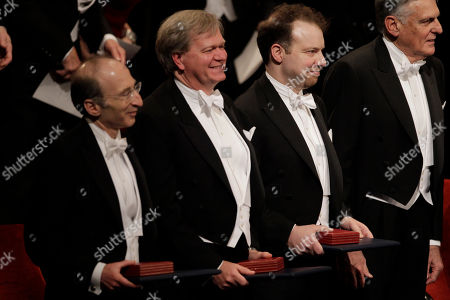 Stock Picture of The 2011 Nobel Prize Laureates for Physics Professor Saul Perlmutter, left, from the U.S., Dr Brian P. Schmidt, center, from Australia and Professor Adam G. Riess, third left, from the U.S. stand together after receiving their Nobel Prizes from Sweden's King Carl XVI Gustaf, not pictured, during the Nobel Prize award ceremony at the Stockholm Concert Hall in Stockholm
