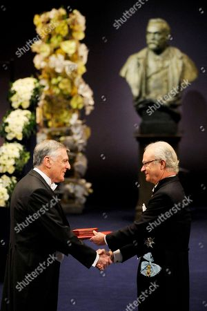 Stock Image of The 2011 Nobel Prize Laureate for Chemistry Professor Dan Shechtman from Israel receives his Nobel Prize from Sweden's King Carl XVI Gustaf, right, during the Nobel Prize award ceremony at the Stockholm Concert Hall in Stockholm