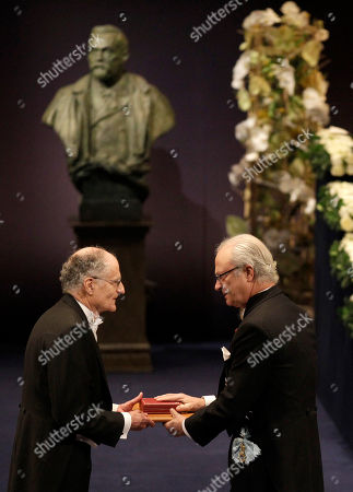 The 2011 Nobel Prize Laureate for Economic Sciences Professor Thomas J. Sargent, left, from the U.S. receives his Nobel Prize from Sweden's King Carl XVI Gustaf during the Nobel Prize award ceremony at the Stockholm Concert Hall in Stockholm