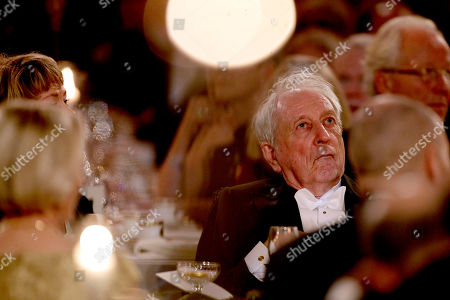 The 2011 Nobel Prize Laureate for Literature author Tomas Transtromer from Sweden listens as his wife Monica makes a speech on his behalf, as he suffered a stroke in 1990 that left him partially paralyzed and unable to speak, during the 2011 Nobel Prize Banquet at the Town Hall in Stockholm