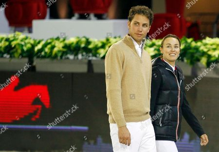 Stock Photo of Martina Hingis, Thibault Hutin FILE - In this Dec. 1, 2011 file picture former tennis player Martina Hingis of Switzerland, right, and her husband Thibault Hutin walk prior a show jumping event at Villepinte, north of Paris. Martina Hingis has been questioned by Swiss police after her estranged husband said he was attacked by the five-time Grand Slam champion and her family. Schwyz canton police spokesman Florian Grossmann says Hingis,her mother Melanie Molitor and her mother's boyfriend Mario Widmer were interviewed at its headquarters last week. Grossmann tells The Associated Press the canton justice department will decide possible further action. No timetable was set for a decision. French equestrian athlete Thibault Hutin has said he was attacked on Sept. 23 at his home in Feusisberg. Hutin claimed Hingis and Molitor hit him, and Widmer struck him with a DVD player