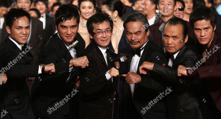 """Wei Te-sheng Bokeh Kosang Lin Ching-tai Taiwanese director Wei Te-sheng, third from left, and Taiwanese actors of the movie """"Warriors of the Rainbow: Seediq Bale"""" Bokeh Kosang, first left, and Lin Ching-tai, forth left, pose with other actors at the 48th Golden Horse Awards, in Hsinchu, northern Taiwan. Wei is nominated for Best Director of the film """" Warriors of the Rainbow: Seediq Bale """" at this year's Golden Horse Awards -one of the Chinese-language film industry's biggest annual events"""
