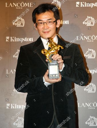 """Wei Te-sheng Taiwanese director Wei Te-sheng poses with his award for Best Feature Film at the 48th Golden Horse Awards, in Hsinchu, northern Taiwan, . Wei won for the film """" Warriors of the Rainbow: Seediq Bale"""" at this year's Golden Horse Awards - the Chinese-language film industry's biggest annual events"""
