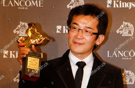 """Stock Picture of Wei Te-sheng Taiwanese director Wei Te-sheng poses with his award for Best Feature Film at the 48th Golden Horse Awards, in Hsinchu, northern Taiwan, . Wei won for the film """" Warriors of the Rainbow: Seediq Bale"""" at this year's Golden Horse Awards - the Chinese-language film industry's biggest annual events"""