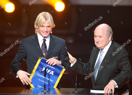 Simone Farina Italian soccer player Simone Farina from 2nd League Club AS Gubbio, left, stands next to FIFA President Joseph Blatter at the FIFA Ballon d'Or awarding ceremony in Zurich, Switzerland. Soccer is falling under a cloud of suspicion as never before, sullied by a multibillion-dollar web of match-fixing that is staining increasingly larger parts of the world's most popular sport. In 2011, Italian defender Simone Farina turned down a fixer's offer of $261,500 to throw a game and reported it to police, setting off an investigation that led to scores of arrests. Despite being honored by FIFA, he found himself shunned by those in Italy who considered him a snitch