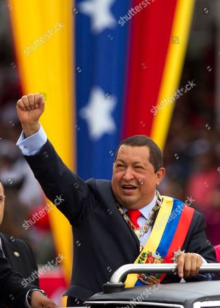 Hugo Chavez Venezuela's President Hugo Chavez gestures during a military parade to commemorate the XX th anniversary of a 1992 failed coup attempt led by him when he was a lieutenant colonel in Caracas, Venezuela, . At right is Chavez's daughter Rosa Virginia Chavez