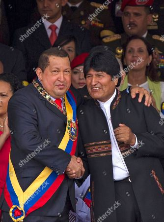 Hugo Chavez, Evo Morales Venezuela's President Hugo Chavez, left, shakes hands with Bolivia's President Evo Morales during a military parade to commemorate the XX th anniversary of a 1992 failed coup attempt led by him when he was a lieutenant colonel in Caracas, Venezuela, . At right is Chavez's daughter Rosa Virginia Chavez