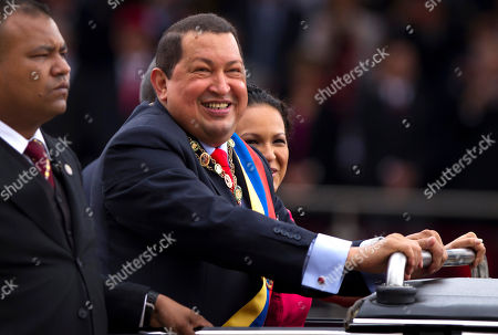 Hugo Chavez, Rosa Virginia Chavez Venezuela's President Hugo Chavez, center, smiles during a military parade to commemorate the XX th anniversary of a 1992 failed coup attempt led by him when he was a lieutenant colonel in Caracas, Venezuela, . At right is Chavez's daughter Rosa Virginia Chavez
