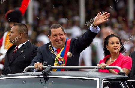 Hugo Chavez, Rosa Virginia Chavez Venezuela's President Hugo Chavez waves during a military parade to commemorate the XX th anniversary of a 1992 failed coup attempt led by him when he was a lieutenant colonel in Caracas, Venezuela, . At right is Chavez's daughter Rosa Virginia Chavez