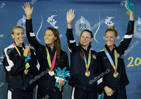 ADDS NAMES ** The United States swimming women's 400 relay team, Madison Kennedy, from left, Elizabeth Pelton, Amanda Kendall and Erika Erndl celebrate their gold medal win at the podium during the Pan American Games in Guadalajara, Mexico, . Brazil won the silver medal