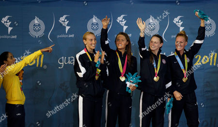 ADDS NAMES ** Brazil's Daynara De Paula, left, points towards the United States swimming women's 400 relay team, Madison Kennedy, second from left, Elizabeth Pelton, third from left, Amanda Kendall, second from right, and Erika Erndl, as they celebrate their gold medal win at the podium during the Pan American Games in Guadalajara, Mexico, . Brazil won the silver medal