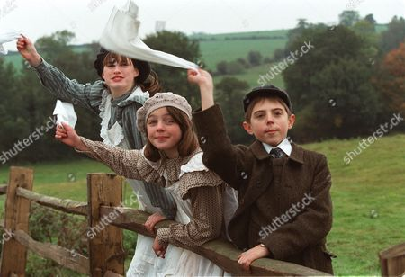 'The Railway Children' - 2000 Jemima Rooper as Bobbie, Clare Thomas as Phyllis and Jack Blumenau as Peter wave at the Green Dragon, they want it to take their love to Father in London.