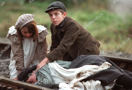 'The Railway Children' - 2000 Trouble on the track - Clare Thomas as Phyllis and Jack Blumenau as Peter tend to Jemima Rooper as Bobbie, who has just fainted.