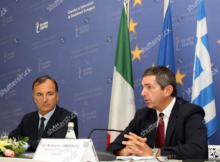 Italian Foreign Minister Franco Frattini, left, and Greek Foreign Minister Stavros Lambrinidis speak at a news conference in Tirana, . The foreign ministers of Italy and Greece are in Tirana to try and talk rival Albanian politicians into agreeing on key reforms required for the country's European Union accession bid