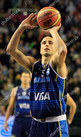Argentina's's Emanuel Ginobili, shoots to score during a FIBA Americas Championship basketball game against Paraguay in Mar del Plata, Argentina, . The top two finishers of the tournament get an automatic berth in the 2012 London Olympics and the next three advance to the last-chance Olympic qualifying tournament to be held in July 2012