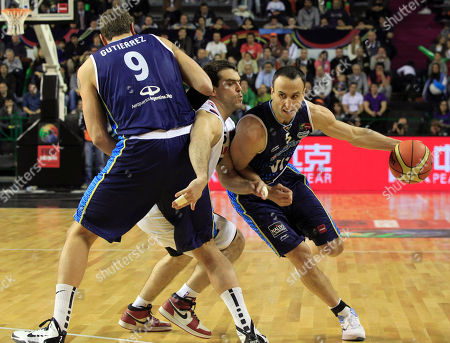 Argentina's's Emanuel Ginobili, right, dribbles past Paraguay's Daniel Perez, center, as Juan Gutierrez, left, blocks during a FIBA Americas Championship basketball game in Mar del Plata, Argentina, . The top two finishers of the tournament get an automatic berth in the 2012 London Olympics and the next three advance to the last-chance Olympic qualifying tournament to be held in July 2012