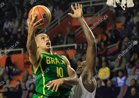 Brazil's Alex Garcia, left, goes up for a shoot over Canada's Joel Anthony during a FIBA Americas Championship basketball game in Mar del Plata, Argentina, . The top two finishers of the tournament get an automatic berth in the 2012 London Olympics and the next three advance to the last-chance Olympic qualifier to be held in July 2012