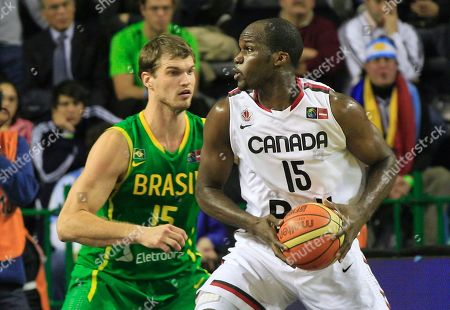 Canada's Joel Anthony, right, drives past Brazil's Tiago Spiltter during a FIBA Americas Championship basketball game in Mar del Plata, Argentina, . The top two finishers of the tournament get an automatic berth in the 2012 London Olympics and the next three advance to the last-chance Olympic qualifier to be held in July 2012