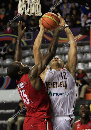 Canada's Joel Anthony, left, blocks Venezuela's Hector Romero during a FIBA Americas Championship basketball game in Mar del Plata, Argentina, . The top two finishers of the tournament get an automatic berth in the 2012 London Olympics and the next three advance to the last-chance Olympic qualifier to be held in July 2012