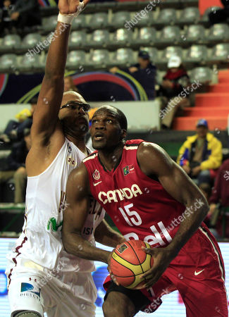 Canada's Joel Anthony, right, dribbles to Venezuela's Gregory Echenique during a FIBA Americas Championship basketball game in Mar del Plata, Argentina, . The top two finishers of the tournament get an automatic berth in the 2012 London Olympics and the next three advance to the last-chance Olympic qualifier to be held in July 2012